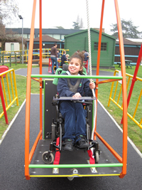 image of girl in wheelchair on swing