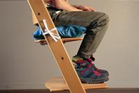 Image of boy seated on cushion