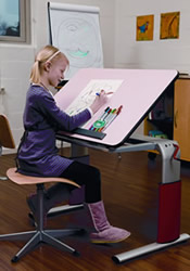 Image of girl working at height adjustable desk