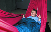Image of boy in Hammock with blankets