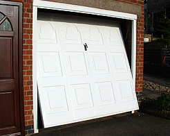 garage door opening as car approaches
