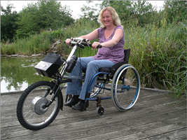 Image of woman riding Viper powered hand cycle