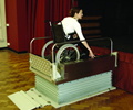 image of portable wheelchair lift in use