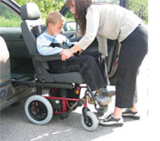 Image of wheelchair user and carer with carony system
