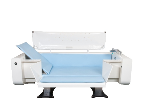 Height adjustable Vanna bath with neatfold changing table