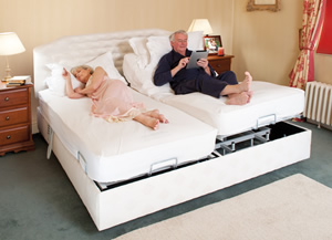Theracare Double bed with independent profiling on each side