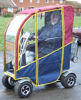 Scooter with weather cab