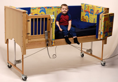 Image of Boy sitting on cot