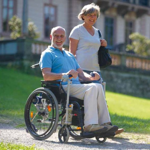wheelchair user with Max 2 add-on power system
