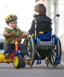 young wheelchair user with Max-e add-on Power Pack