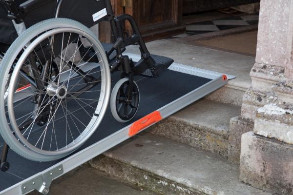Wheelchair ascending steps on premium ramp