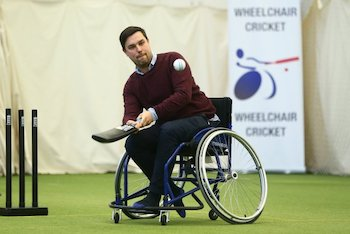 Playing wheelchair cricket